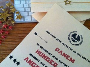 I saw an invitation online and I just made my own version of it using some clip art and a Hunger Games font.